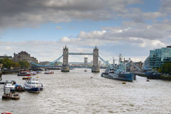 Tower Bridge and HMS Belfast on the Thames. View up the river thames in London towards Tower Bridge and HMS Belfast Royalty Free Stock Photos