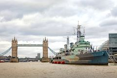 Tower Bridge and with tourists visiting HMS Belfast royalty free stock photography