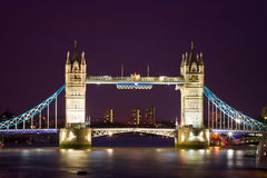 Tower Bridge illuminated at night time stock photos