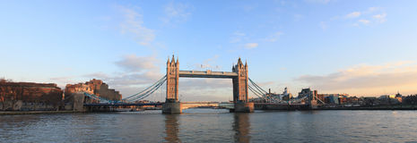 Tower bridge London. A panoramic view of Tower Bridge London, as seen from the river Thames at sunset Royalty Free Stock Image