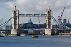 Tower Bridge - London. Tower Bridge in London. The long exposure creates a beautiful effect on the waters of the river Thames and the clouds passing over the Stock Image