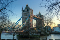 Tower Bridge, London. Tower bridge at sun set with some tourists figures at the front view Royalty Free Stock Photo