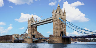 Tower Bridge in London with brilliant Blue Cloudscape sky royalty free stock images