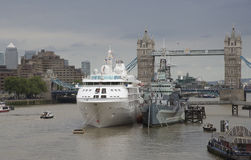 Tower Bridge London a cruise ship and HMS Belfast Stock Photo