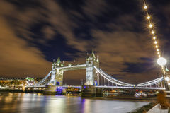 Tower Bridge in London England. Being light with street lights and bridge lights famous tourist  place and river Thames Royalty Free Stock Photo