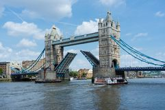 Tower Bridge in London England. Tower Bridge London, England with both bascules raised for a Thames Barge Royalty Free Stock Photos