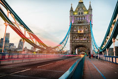 Tower Bridge in London, England. Tower Bridge in London, UK at night with moving red double-decker bus leaving light traces Stock Photo