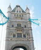 Tower Bridge in London - facade of a tower. Tower Bridge (built 1886–1894) is a combined bascule and suspension bridge in London. The bridge crosses the royalty free stock photography
