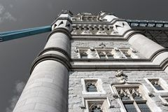 Tower Bridge in London - front of tower from below. Tower Bridge (built 1886–1894) is a combined bascule and suspension bridge in London. The bridge crosses Stock Image