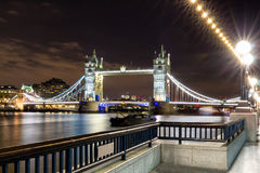 The Tower bridge in London illuminated at night.  Royalty Free Stock Images