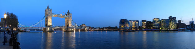 Tower Bridge, London at night. Tower Bridge and the Thames panoramic view about London at night stock photo