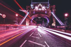 Tower Bridge in London at night with car traffic light trails. Stunning view of Tower Bridge in London Royalty Free Stock Image