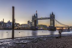 Tower Bridge in London at night or sunset. Old Tower Bridge in London at night or sunset over the river Thames with yellow light behind Stock Photography