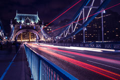 Tower Bridge London at night with traffic light trails. Stunning view of Tower Bridge in London Royalty Free Stock Images