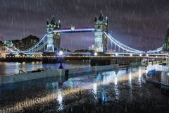 The Tower Bridge in London on a rainy winter night Royalty Free Stock Image