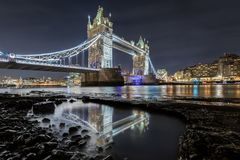 The Tower Bridge of London seen from the river Thames bank stock photo