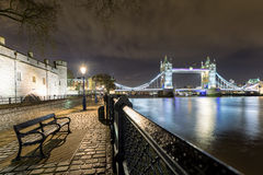 The Tower Bridge in London seen from the Tower by night Stock Image
