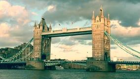 Tower Bridge, London, skyline at sunset with Thames river lights reflected on river, famous London landmark