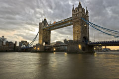The Tower Bridge in London at sunset. The Tower Bridge and Town Hall in London at sunset Royalty Free Stock Images