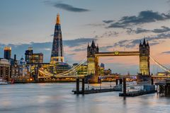 The Tower Bridge in London after sunset. With the Shard in the back Royalty Free Stock Photo