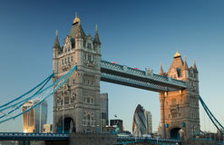 Tower bridge in London at sunset. Tower bridge in London at sunset witht eh Ghekin and Walkie-talkie buildings in view in 2016 Stock Photos
