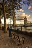 Tower bridge london during susnset. View of london bridge with bench and street lamp during sunset stock image