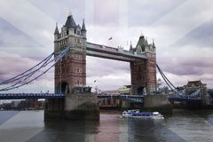 Tower Bridge in London with a transparent British Union Jack flag over it royalty free stock image