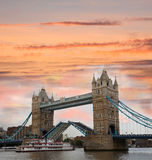 Tower Bridge in  London, UK. Famous Tower Bridge after sunset  in the evening with steam boat,  London, UK Royalty Free Stock Images