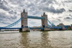 The Tower Bridge of London, UK. Ancient landmark on a cloudy day Royalty Free Stock Photography