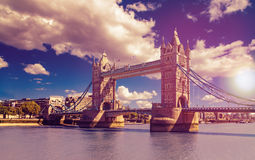 Tower Bridge in London, UK. The bridge is one of the most famous landmarks in Great Britain, England. Picture in a dreamy purple look with sunset feeling Royalty Free Stock Images
