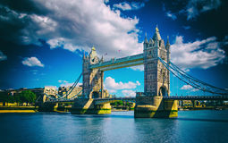 Tower Bridge in London, UK. The bridge is one of the most famous landmarks in Great Britain, England. Picture with sunlight and cloudy sky with high contrast Royalty Free Stock Photos