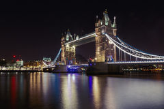 Tower Bridge in London, UK at night time. Tower Bridge in London, UK, illuminated at night time with reflection from Thames royalty free stock photo