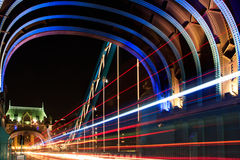 Tower Bridge in London, UK at night time. With moving red double-deck royalty free stock image