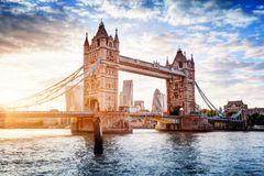 Tower Bridge in London, the UK at sunset. Drawbridge opening. Tower Bridge in London, the UK. Sunset with beautiful clouds. Drawbridge opening. One of English Stock Photo