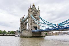 Tower Bridge in London, wide angle view over River Thames. Tower Bridge in London, England, United Kingdom. Wide angle view over River Thames from low down stock image