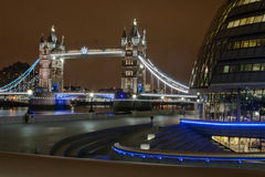 Tower Bridge at night. Tower bridge and modern building in London at night royalty free stock image
