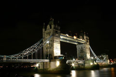 Tower Bridge by night. Taken from river Thames riverbank Stock Photos