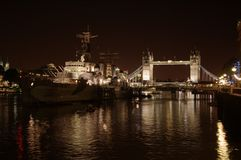Tower Bridge at night. The Tower of London and HMS Belfast , a museum ship, seen at night Royalty Free Stock Photography