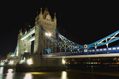 Tower Bridge at night: aside perspective, London. Night view of Tower Bridge perspective from the Thames bank, City of London, England, United Kingdom Royalty Free Stock Images