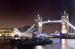 Tower Bridge by night with Boat Royalty Free Stock Photo