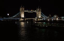 Tower bridge with night illumination in London, United Kingdom. Bridge over Thames river with dark water with nice. Architecture. Structure and design royalty free stock photography