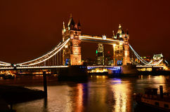 Tower Bridge at night, London. Tower Bridge in London, night city view with the river Thames and high buildings in background royalty free stock photo