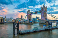 Tower Bridge at Night. The London Tower Bridge and the southern bank of the Thames river at sunset Stock Photos