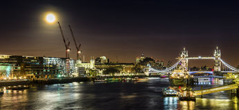 The Tower Bridge by Night With the Moon Stock Image