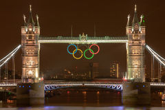 Tower Bridge at night with Olympic Rings. The iconic Tower Bridge in London, UK, with the Olympic rings for London 2012 (http://www.london2012.com Stock Images