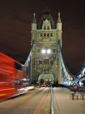 Tower Bridge night perspective, London. Night view of a popular tourist attraction - Tower Bridge, with red double-decker blurred in motion, London, England Royalty Free Stock Image