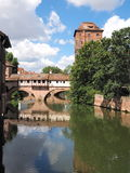 Tower, bridge and old houses with the Pegnitz river Stock Image