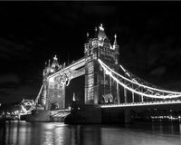 Tower bridge and Olympic rings. Nighttime black and white view of the illuminated tower bridge and Olympic rings Stock Photography