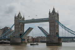 Tower Bridge Open. Tower Bridge, London, seen from City Hall Plaza, open to admit an historic tall-masted Thames Sailing Barge into the Pool of London Royalty Free Stock Photo