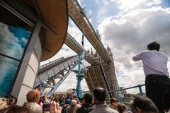 Tower Bridge open scene in London. London, England - July 20, 2008 : A lot of people are watching Tower Bridge opening scene stock images